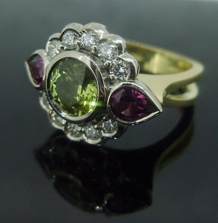 18ct yellow and white gold ring with Mali Garnet, Rhodalite Garnets and Diamonds.