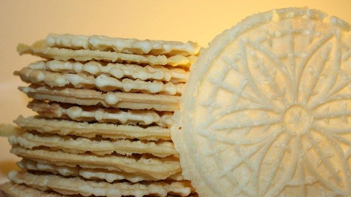 This recipe calls for a batter-like dough and is baked on a pizzelle iron. Powdered sugar adds an elegant touch. In the Italian version, vanilla is replaced by anise. Chocolate may also be used.