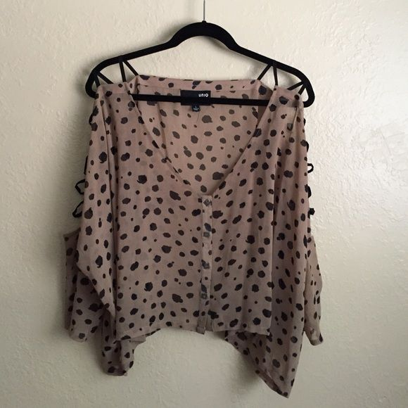 Crop Animal Print Top w/open shoulders Flowy crop top with open top sleeve and strappy design. Worn once for one hour, in perfect condition. ✅Reasonable offers accepted. Comments asking 'lowest' will be ignored. Please make offer instead!                                                                  🚫No Trades  // NO 🅿️🅿️                                                        🎁Bundle discounts! Tops Blouses
