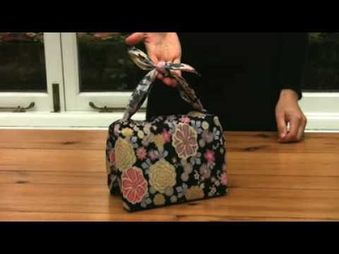 Furoshiki gift wrapping.  Japanese style wrapping using scarves or fabric instead of paper.  via youtubefuroshikiwrapping.com