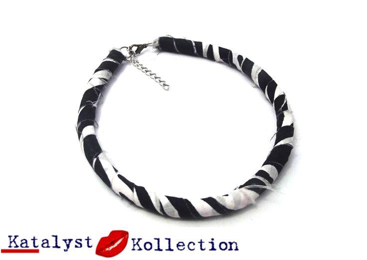 http://katalystkollection.co.za/index.php/accessories/product/270-zebra-print-single-choke-necklace