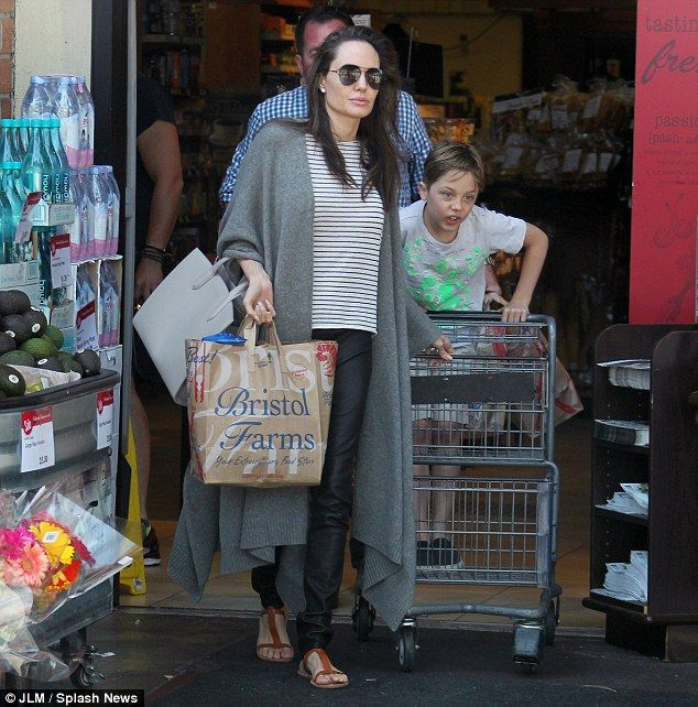Back in California: Angelina Jolie and seven-year-old son Knox went on a groceries run in Los Angeles on Thursday