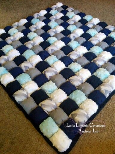Puff quilt/ bubble blanket/ biscuit quilt for a baby boy, with six different designs: solid black flannel, pale minky blue, minky white, light and dark chevron grey, solid grey, and solid navy blue. The back of this quilt is solid black in cozy flannel. This puff quilt is a standard large, 13X13 puffs and approximately 36X36 inches. Made to order.