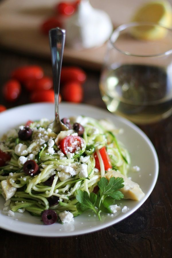 Mediterranean Zucchini Noodle Pasta - zucchini squash, cherry tomatoes, artichoke hearts, pitted kalamata olives, olive oil (would reduce or omit), fresh lemon uice, lemon zest, white vinegar, garlic cloves, fresh parsley, kosher salt, crumbled feta cheese (for serving)
