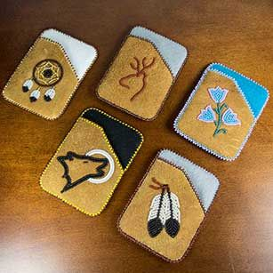 Carry you credit or debit cards in style with a hand beaded moosehide card holders.Dene artists create these works of art with scenes from the Fort Liard area. Most card holders have flower or animal designs.Available in a number of different colours, while quantities last.�