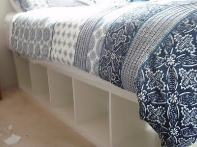 Bed frame made out of 2 IKEA Expedit bookcases...this is such a great idea, I wonder how sturdy it is though?