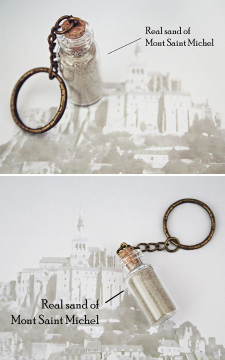 Keyring decorated with a small glass bottle filled with real sand coming from Mont Saint Michel, Normandy - France. The bottle is sealed by a point of strong glue on the cork stopper (to make sure it does not open) and is mounted on a bronze colored chain.  #keyring #keychain #religious #bronze #sand #of #Mont #Saint #Michel #st #made #in #france #jewelry #present #etsy #beach #in #bottle #archangel #st #michael #protection #amen #gift #wedding #birthday #christmas