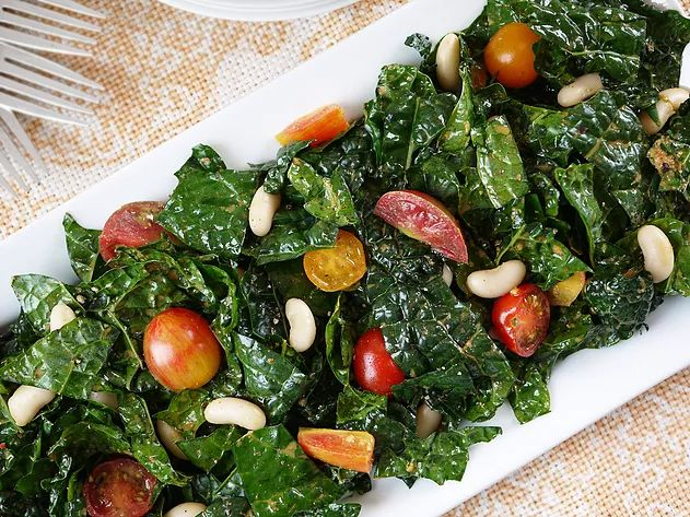 Massaged Kale Salad with Berkshire Cherry Tomatoes and White Beans Even kale needs to relax! Try our marvelous massaged kale salad!