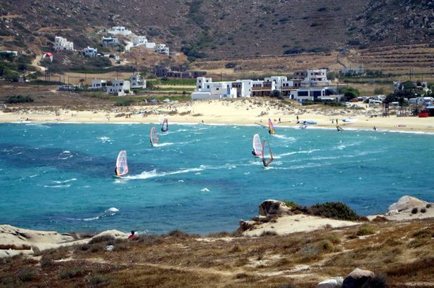 Kite-surfing in Naxos. The rolling fertility of this mountainous and well-cultivated island, its renown produce & the sandy beaches, make this island a classic choice for many tourists. #FiveStarGreece #LuxuryVillas #HolidayMatchmakers