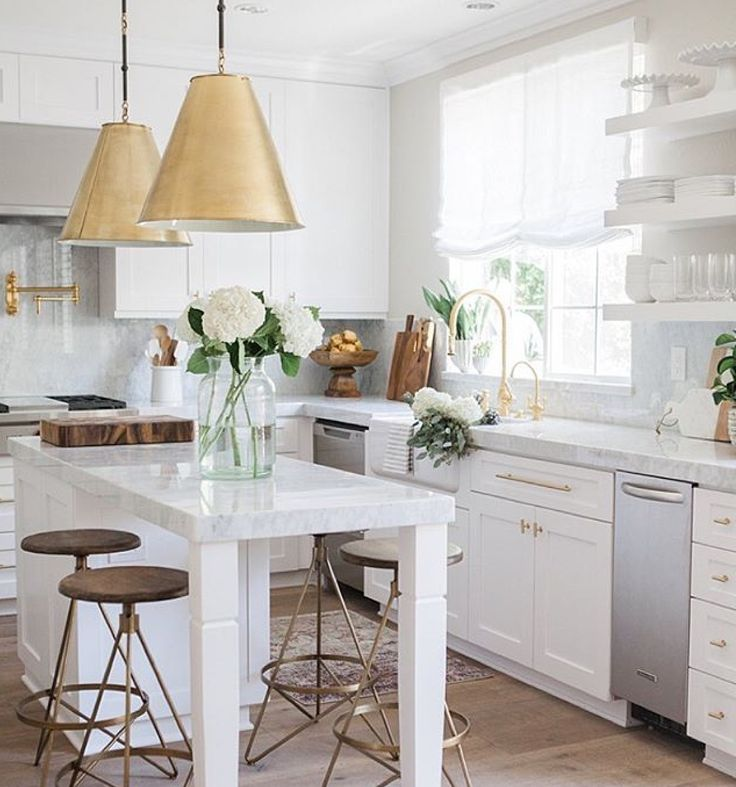 White and gold kitchen.