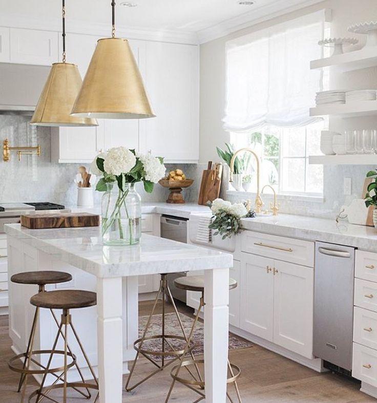 White and gold kitchen.