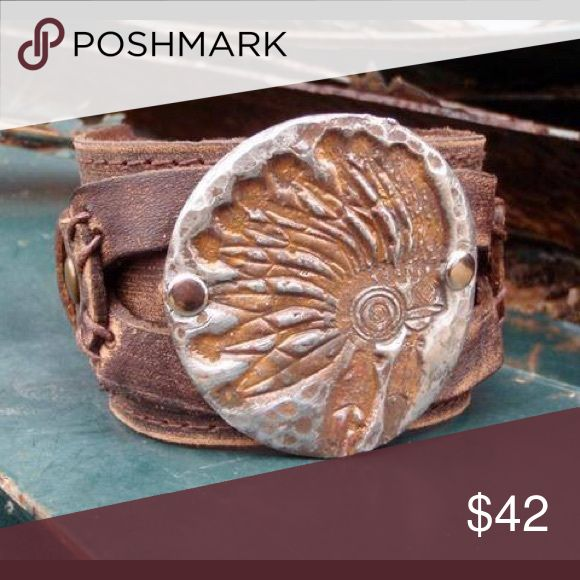 """Distressed Headdress Cuff Each hand-distressed cuff is made with genuine leather and features two adjustable snaps. Entire length of bracelet is 2"""" by 9"""".  Adjusts with snaps from Approx. 7"""" to 7.5"""".  Plated cuffs are hand-stamped. This high quality, hand-crafted jewelry is made right here in Texas. These unique pieces are created by hand so no two cuffs will look the same. Expected delivery date is November 20th. Pre-order yours today! Jewelry Bracelets"""