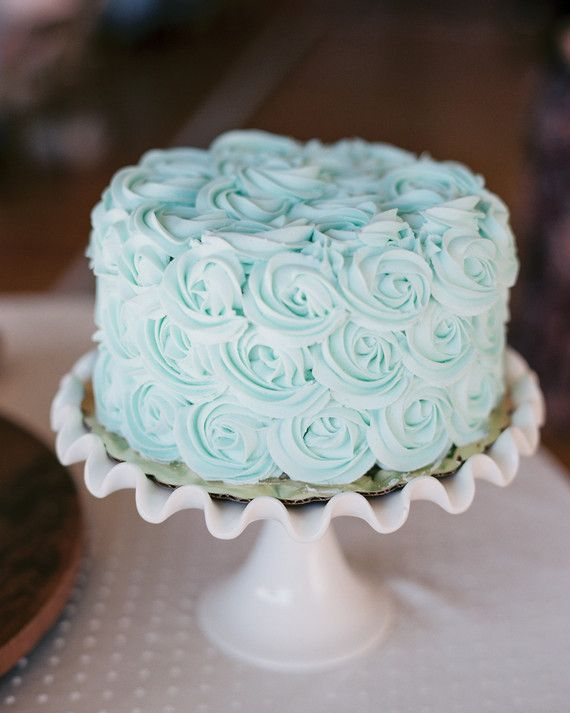 """For her """"something blue,"""" this bride chose a single-tiered mint-chocolate creation with pale blue rose-swirled icing courtesy of Buttercup Bakery."""