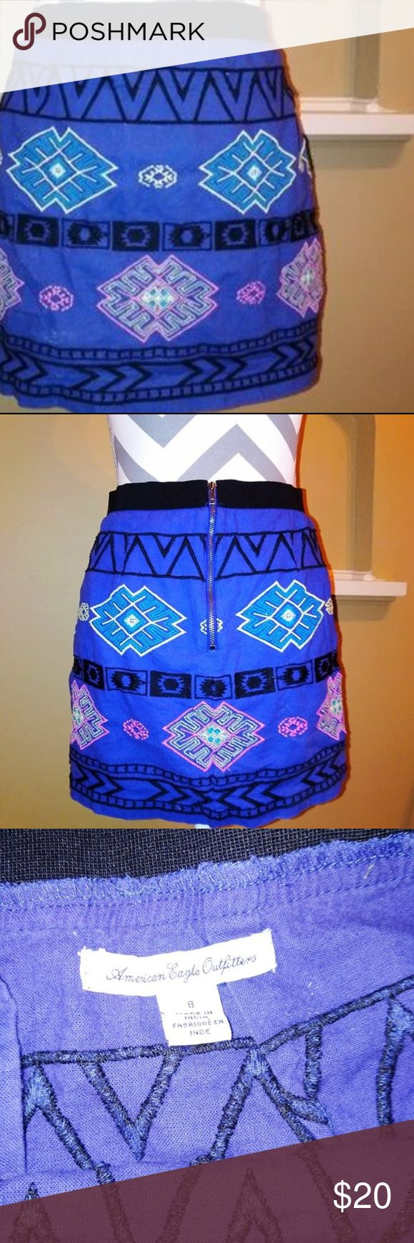 """AEO Aztec Tribal Embroidered Skirt NWOT AEO Aztec Tribal Embroidered Skirt, size 8.  Gorgeous Purple Colored Skirt with Tribal Pattern Embroidered upon it.  Skirt is 14.5"""" long, has 14"""" waist, measured laid flat, with 6"""" bronze colored zip located at center back of skirt.  No imperfections. American Eagle Outfitters Skirts A-Line or Full"""