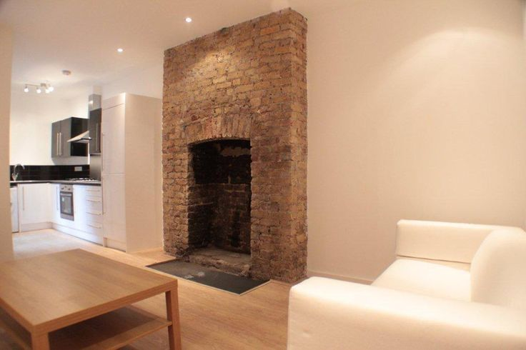 Exposed brick chimney breast