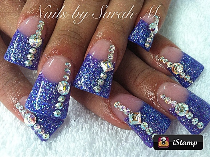 Flared Blue bling acrylic nail design by Sarah