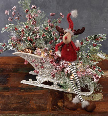 Decorating ideas from the RAZ Aspen Sweater Collection using one of the larger elves and knitted ornaments.