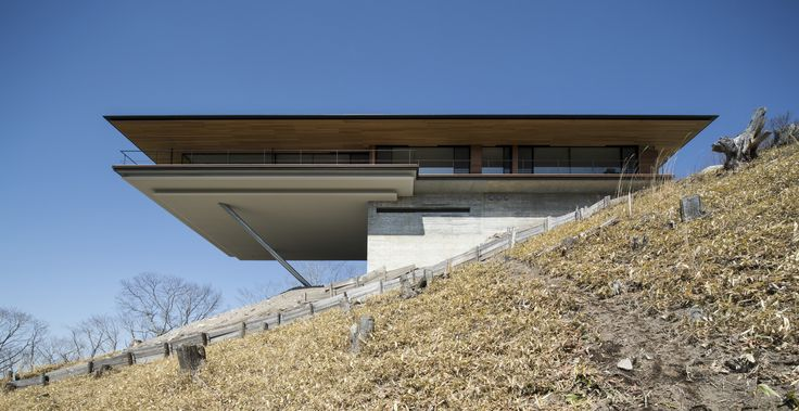 Built by Kidosaki Architects Studio in Nagano, Japan with date 2012. Images by 45g Photography . Located on a sloping mountain ridge at the foot of the Yatsugatake Mountains, this house was designed on a piece of l...