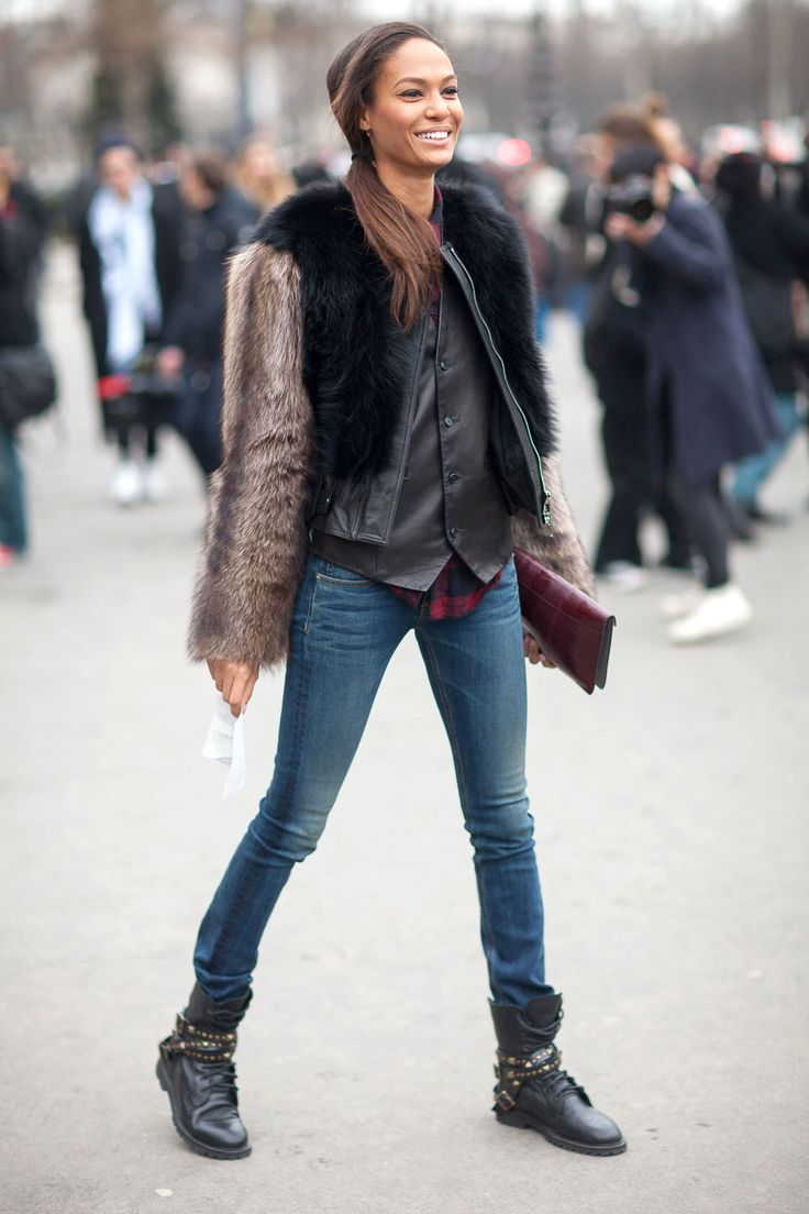 Joan Smalls in a Givenchy coat // Love the furry arms on her jacket and her grunge boots #streetstyle