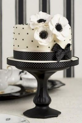 Black & white polka dot wedding cake with floral detail