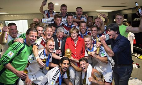 Chancellor Angela Merkel with the Germany team