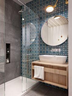 banheiro com parede de pedra e espelho redondo