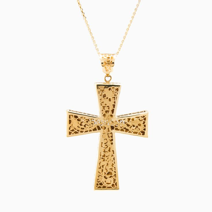 This exquisite and unique cross in handcrafted using the cannetille filigree technique in 14k yellow gold.