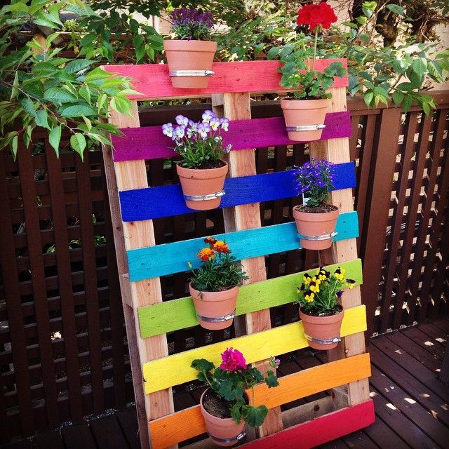 Colorful pallet planters storage