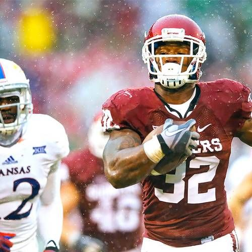 Oklahoma running back Samaje Perine continues to bring in the postseason accolades, as he was named a True Freshman All-American by ESPN.com.    Perine, who broke the FBS single-game record for rushing yards (427) on his way to 1,579 yards and 21 touchdowns, is one of only three Big 12 players on ESPN's 22-man roster. Perine is joined by Baylor wide receiver KD Cannon on the offense, and West Virginia defensive back Dravon Henry was named to the defense.    USC and Tennessee were the only…