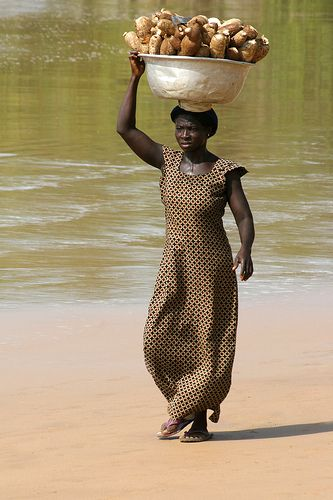 Ghana.  On her way home from the market. | Flickr by cookiesound