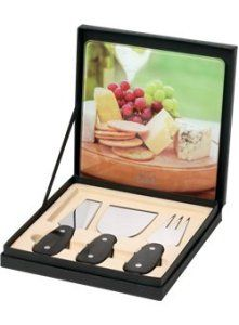Rhone Cheese Set. This gift set comes complete with tempered glass cutting board, and three cheese utensils. The utensils have Manchurian Ash wood handles. Made of FDA compliant materials and packaged in a gift box.