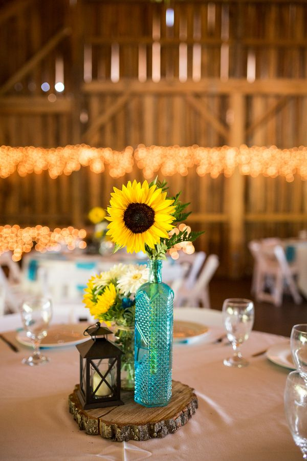 Rustic Floral Centerpiece  {Turquoise & Sunflowers} Rustic Wedding at Betsy's Barn Photographer: Ctg Photography