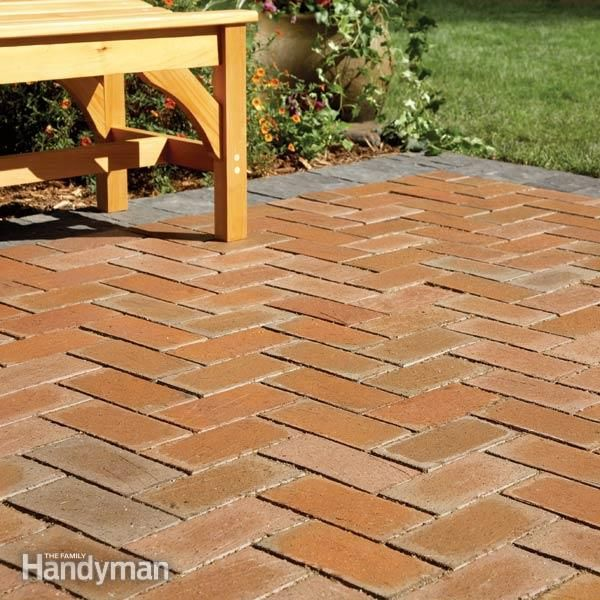 No need to tear up that concrete slab, just cover it up with concrete pavers!