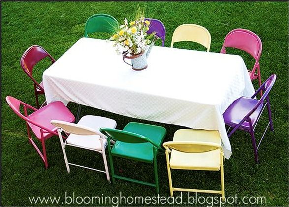 If you have to have extra folding chairs for parties, why keep them brown? check out these spray painted folding chairs! Perfect for a party!