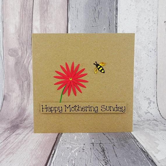 Mothers Day card with a bee and flower for Mum / Mom.  This handmade bee and flower card has a flower (daisy), with a bee approaching it flying in the air. The bee has gems for wings and the the flower colour can be chosen from the drop-down menu. The sentiment on this Mothering Sunday