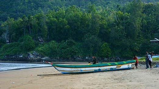 Fishing boat: Other than surfing, you can stroll along the Teleng Ria beach to the west, where there is a small harbor f...