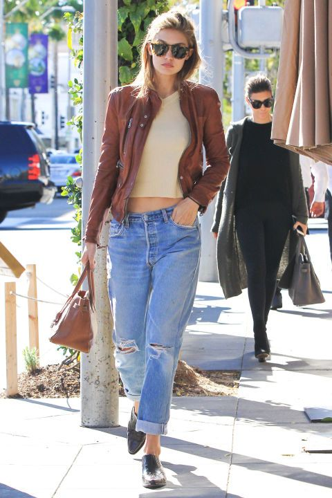 38 outfit ideas for jeans from the most stylish celebs: Gigi Hadid's styles her distressed boyfriend jeans with a suede jacket and nude top