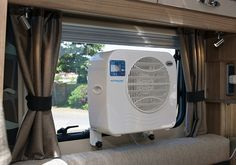 Cool My Camper - Air Conditioning For Caravans and Motorhomes.  Hook up to solar and would be great for tiny home.