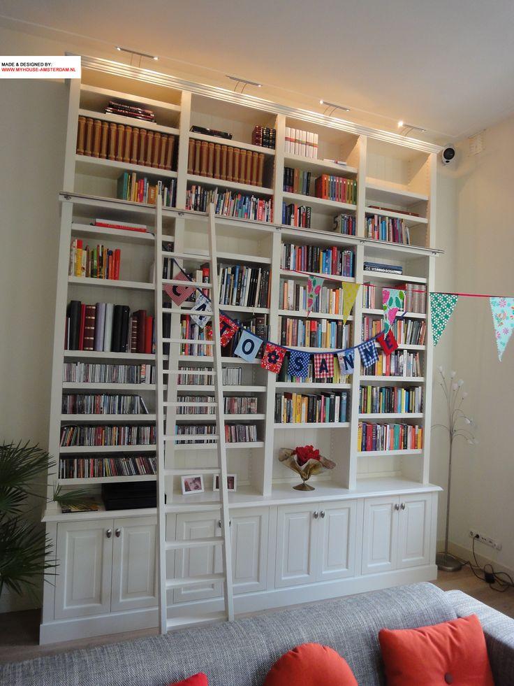 Nice high and custom made bookcase and bookshelves - Maatwerk boekenkast met ladder en rail door www.myhouse-amsterdam.nl