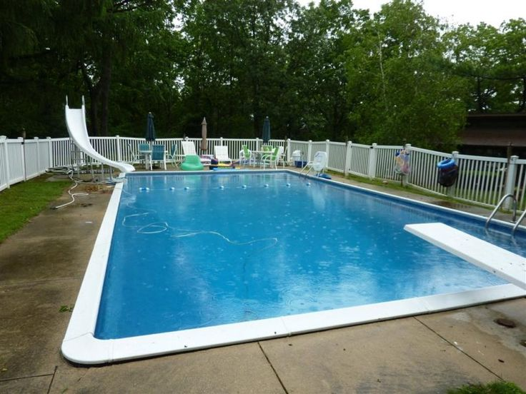 Swiming Pools Pool Slide With Wooden Fence Also Diving Pool And Green Outdoor Umbrella Besides In Ground Pool Liner  Garden Design Ideas  Landscaping Design  Wooden Patio Chair  Wooden Outdoor Table  Outdoor Floor Heater   The Kinds of In Ground Pool Liners