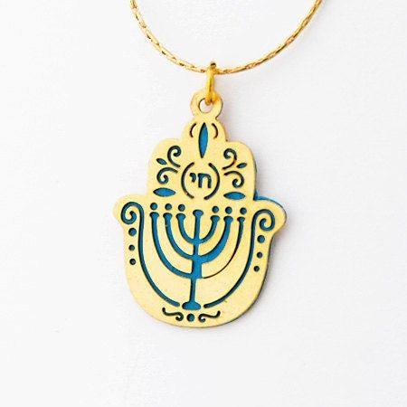 Made of aluminum and topped with 24K gold, this Hamsa is truly a unique piece. In the Jewish tradition, the Hamsa hand is believed to ward off the