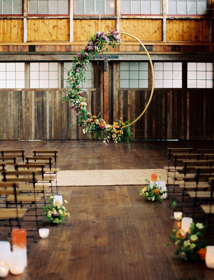 hanging floral hoop wedding ceremony backdrop