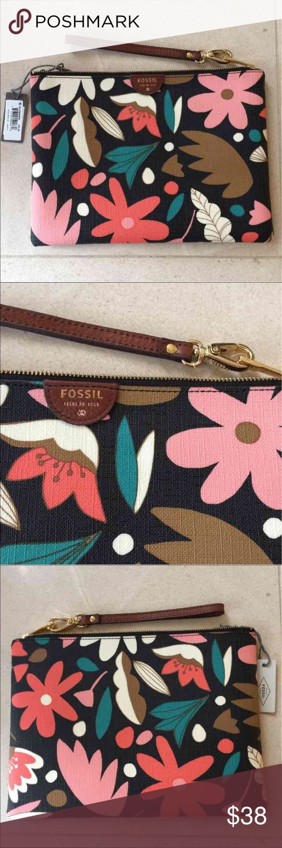 ❤️🌺😍FOSSIL dark floral large wristlet❤️😍🌺🌸 Retail: $50 😍❤️🌺💋 PRETTY!!! ❤️❤️❤️  ***NOT from the outlet store. All Fossil wallets in my store are from department stores like Nordstrom or Macy's.   A dark floral print adds a fresh touch to this printed PVC wristlet.  The gorgeous wallet is large enough to hold a Samsung Galaxy S4®, iPhone® 6, and iPhone 6 PLUS.  6 Credit Card Slots  Exterior Material: 100% Polyvinyl Chloride (PVC) Closure: Zipper Handles/Straps: 1 Wristlet Strap…