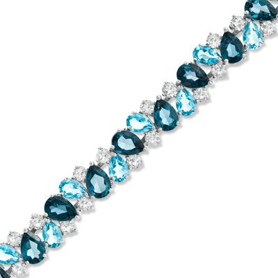 A glistening array of pear-shaped London and Swiss blue topaz gemstones.