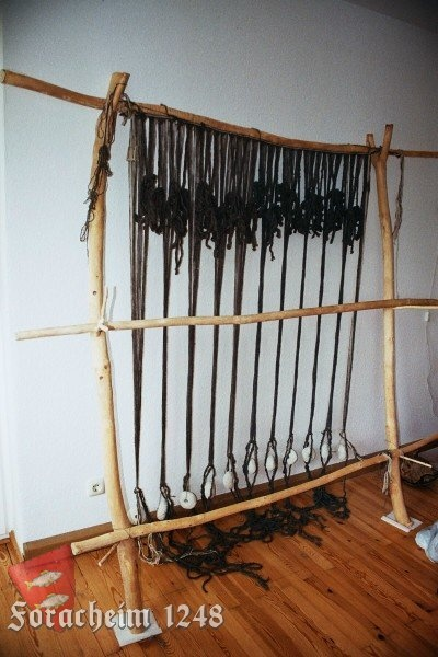 Warping in progress -- tying the back weights. Note the cards on the side for making tablet-woven selvages.