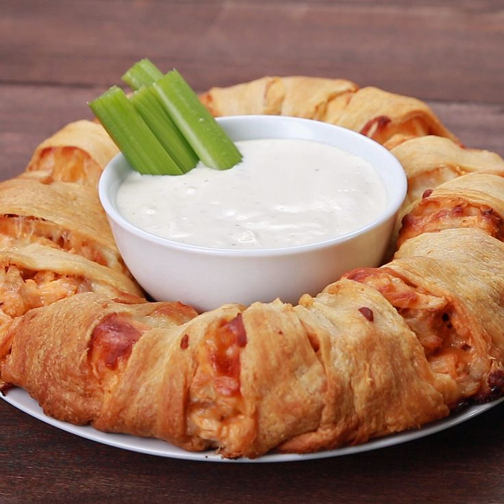 Buffalo Chicken Ring Ingredients: - 4 oz cream cheese - 1/4 cup hot sauce - 2 1/2 cups cooked chicken - 1 cup shredded Monterey Jack cheese - 1 cup Mozzarella cheese - 2 cans (8 oz each) refrigerated crescent dinner rolls.