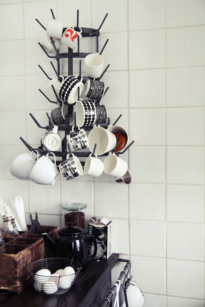 cup rack, or good idea for a pot rack solution. Love the use of vertical space.