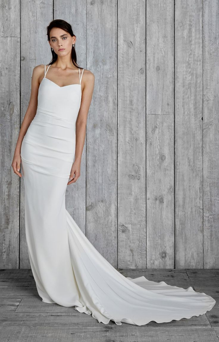 Our Celine gown is made from luxurious stretch silk with a low open back and elegant crisscross straps. The signature Nicole Miller side and back ruching is ...