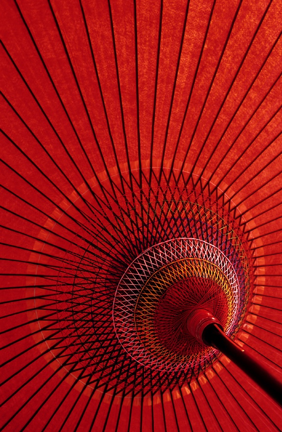 Detail of a red umbrella used in Japanese tea ceremonies performed outdoors.