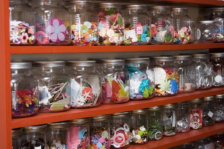 THIS.  This is what I picture in my head for my future craft room-- embellishments in jars -- but mine will be mason jars.